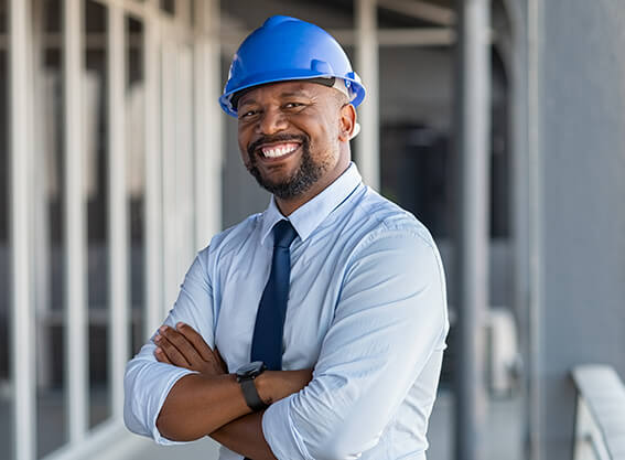 An African-American male architect with DEC Contracting Group manages the construction site.
