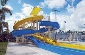 DEC Contracting Group constructed a blue, 122-foot waterslide and a yellow 177-foot open waterslide for the Eagle Lakes Aquatic Center